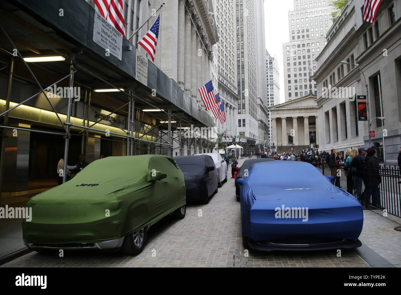 Covered cars sit at the entrance to the NYSE on the day Fiat Chrysler Automobiles begins trading for the first time at the New York Stock Exchange on Wall Street in New York City on October 13, 2014. Fiat Chrysler Automobiles began trading on the New York Stock Exchange on Monday under the symbol FCAU.     UPI/John Angelillo Stock Photo