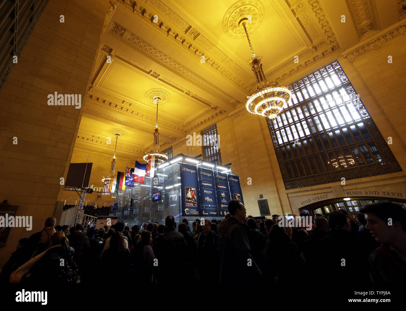 People gather around the court at JPMorgan Chase & Co.'s 18th annual  'Tournament of Champions' Professional Squash Tournament in Grand Central Terminal in New York City on January 16, 2015. The annual tournament is scheduled to continue through January 23rd.      Photo by John Angelillo/UPI - Stock Image