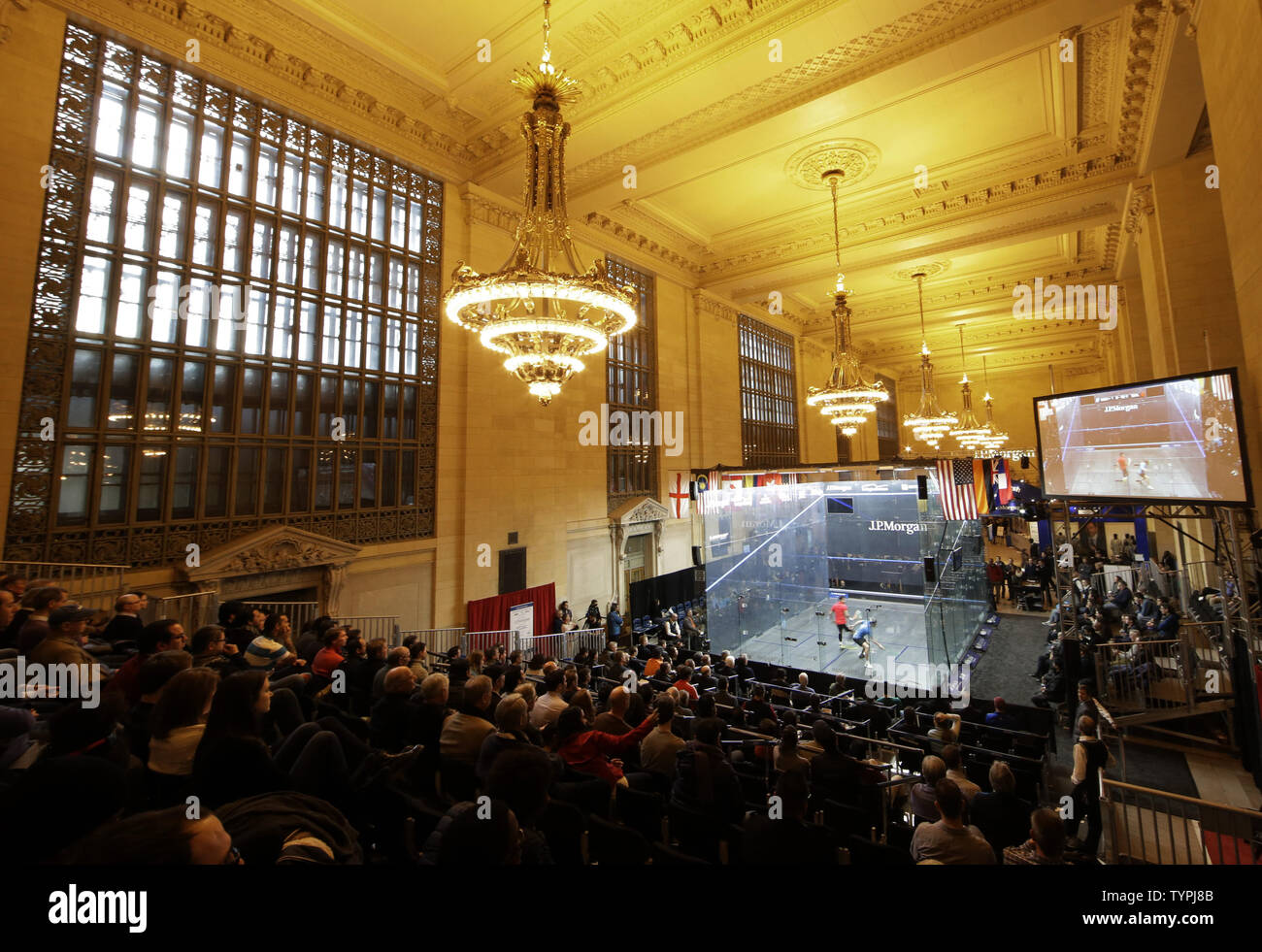 Fans sit in the stands and watch the action at JPMorgan Chase & Co.'s 18th annual  'Tournament of Champions' Professional Squash Tournament in Grand Central Terminal in New York City on January 16, 2015. The annual tournament is scheduled to continue through January 23rd.      Photo by John Angelillo/UPI - Stock Image
