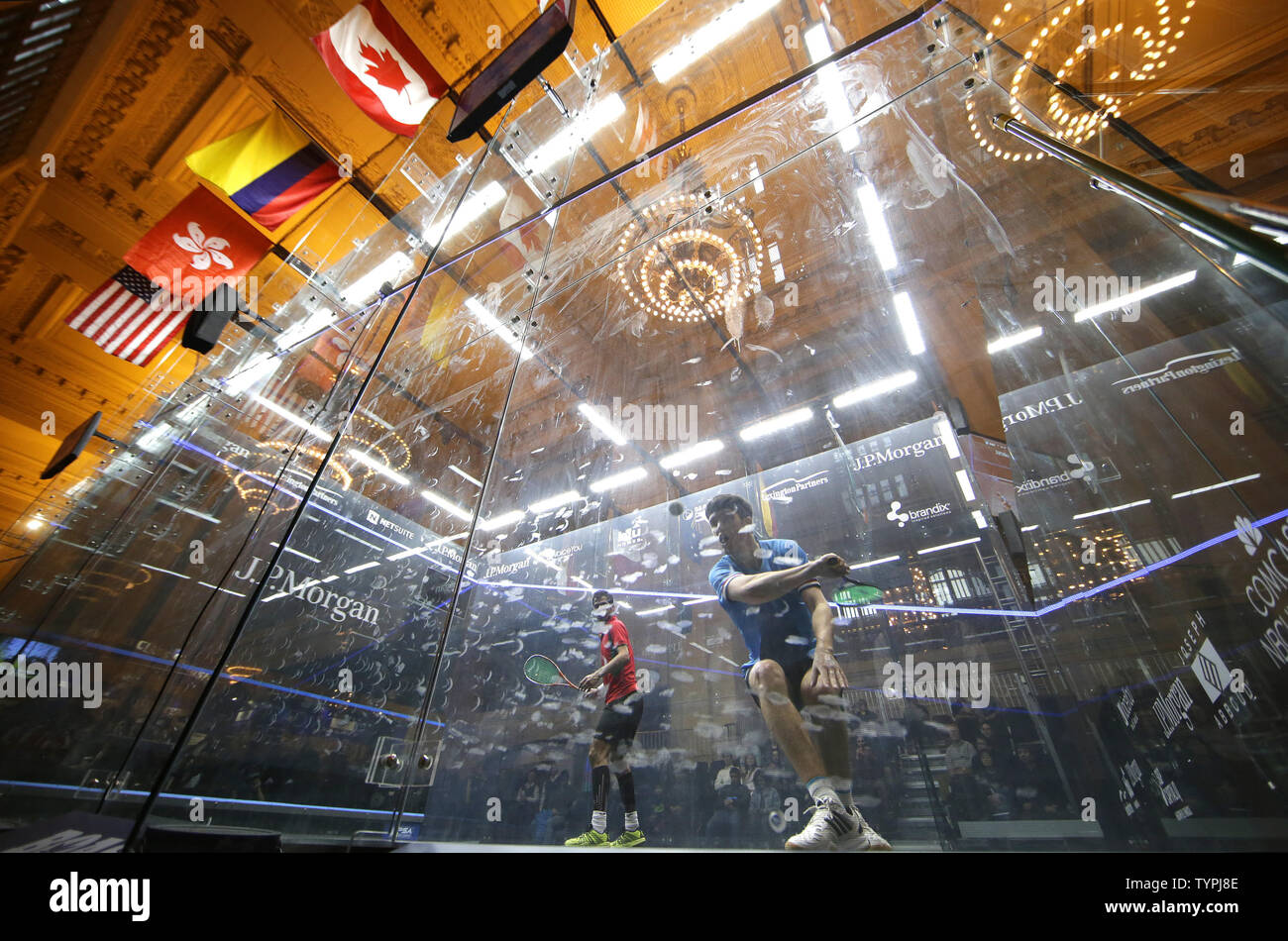 Chris Simpson of England hits a backhand in his match against Cesar Salazar of Mexico at JPMorgan Chase & Co.'s 18th annual  'Tournament of Champions' Professional Squash Tournament in Grand Central Terminal in New York City on January 16, 2015. The annual tournament is scheduled to continue through January 23rd.       Photo by John Angelillo/UPI - Stock Image