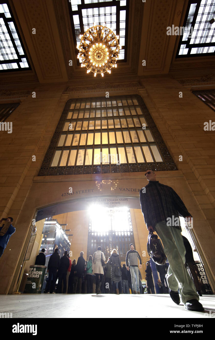 People exit and enter Vanderbilt Hall at JPMorgan Chase & Co.'s 18th annual  'Tournament of Champions' Professional Squash Tournament in Grand Central Terminal in New York City on January 16, 2015. The annual tournament is scheduled to continue through January 23rd.      Photo by John Angelillo/UPI - Stock Image