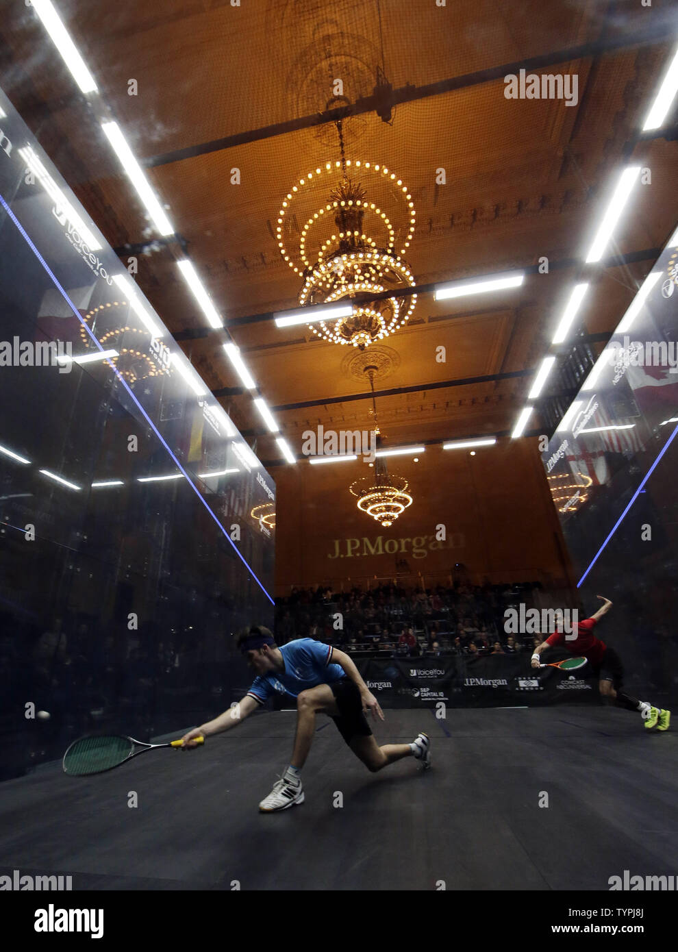 Chris Simpson of England hits a forehand in his match against Cesar Salazar of Mexico at JPMorgan Chase & Co.'s 18th annual  'Tournament of Champions' Professional Squash Tournament in Grand Central Terminal in New York City on January 16, 2015. The annual tournament is scheduled to continue through January 23rd.       Photo by John Angelillo/UPI - Stock Image
