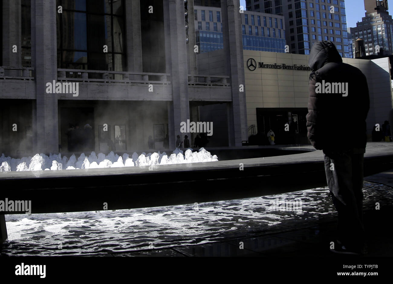 Steam rises off of the fountains outside of Lincoln Center during the week of Mercedes-Benz Fashion Week Fall 2015 in New York City on February 13, 2015. Temperatures fell into the teens in New York with snow expected tomorrow through Sunday.      Photo by John Angelillo/UPI - Stock Image