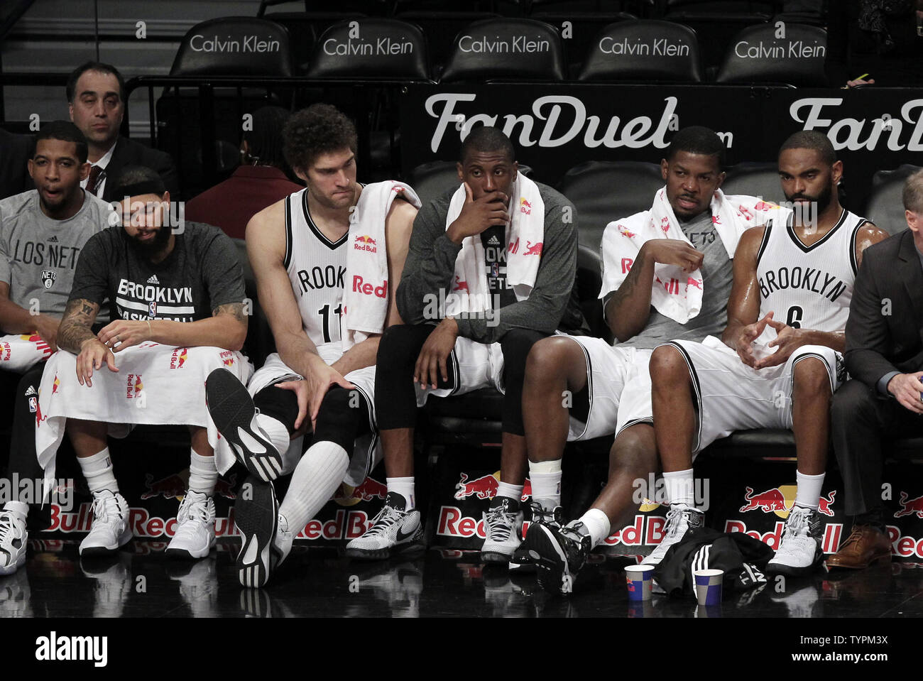 Brooklyn Nets Deron Williams, Brook Lopez, Thaddeus Young, Joe Johnson and Alan Anderson sit on the bench in the 4th quarter against the Charlotte Hornets at Barclays Center in New York City on March 4, 2015. The Hornets defeated the Nets 115-91.      Photo by John Angelillo/ UPI - Stock Image