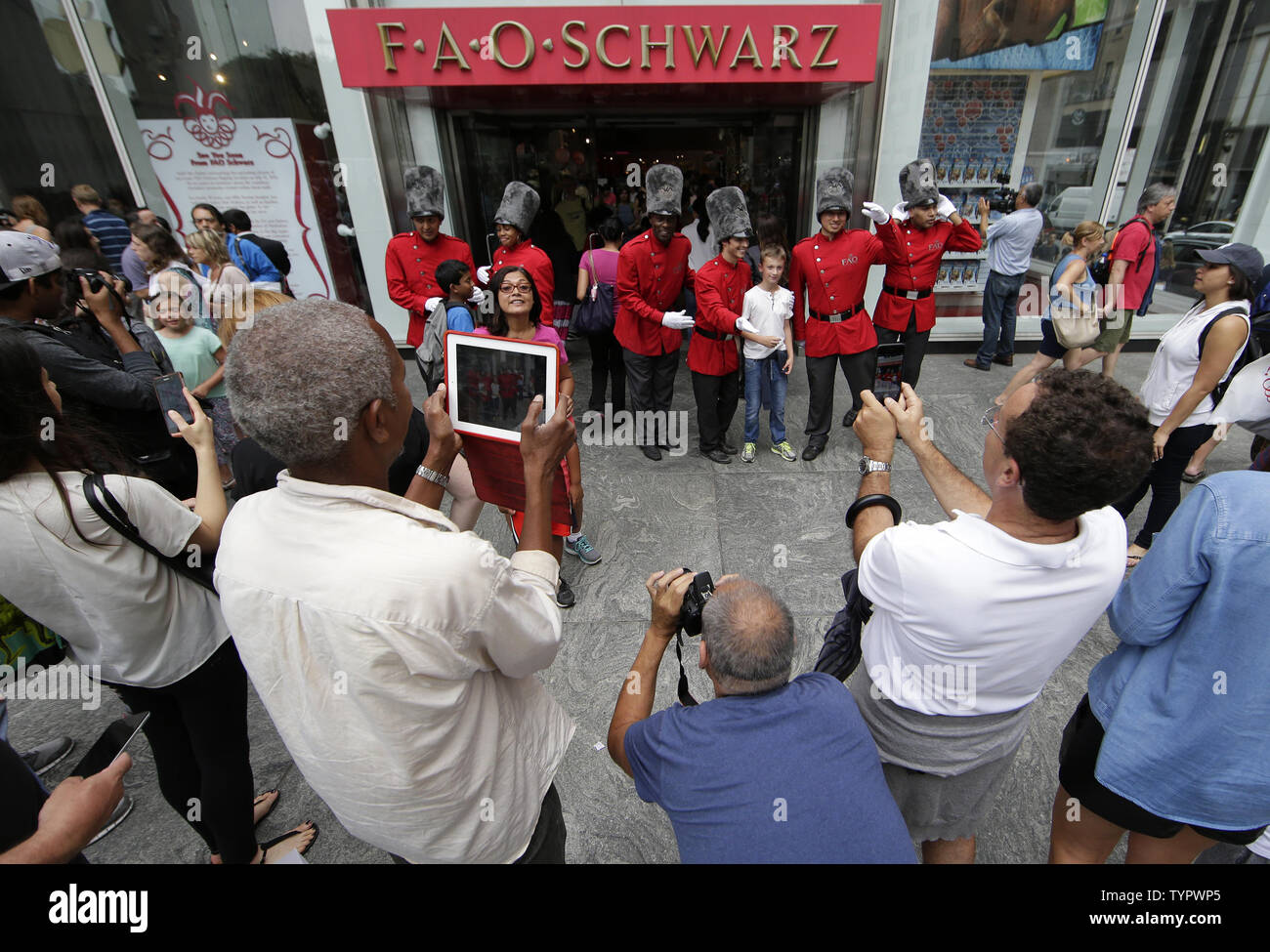 Customers gather outside at FAO Schwarz on its last day of business