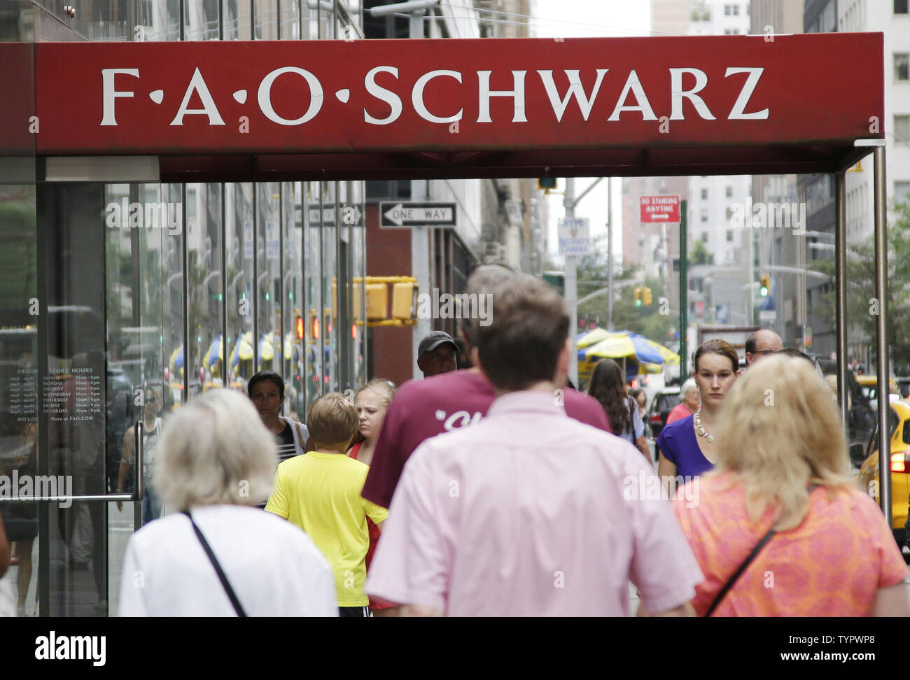 People walk by FAO Schwarz on its last day of business on 5th Avenue