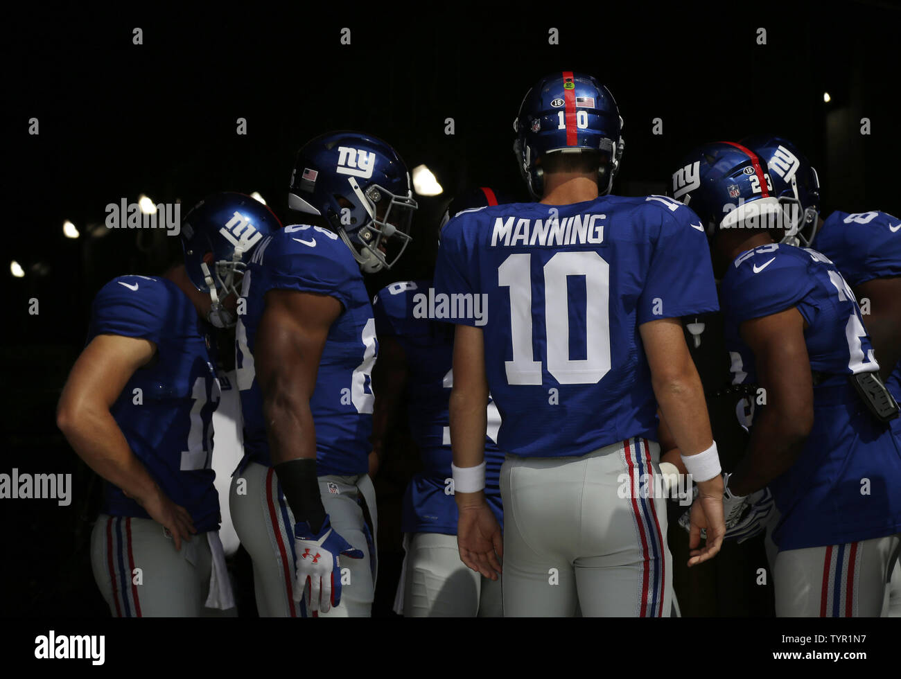 detailed pictures eaa8f 6c54b New York Giants Eli Manning stands in a huddle in the tunnel ...