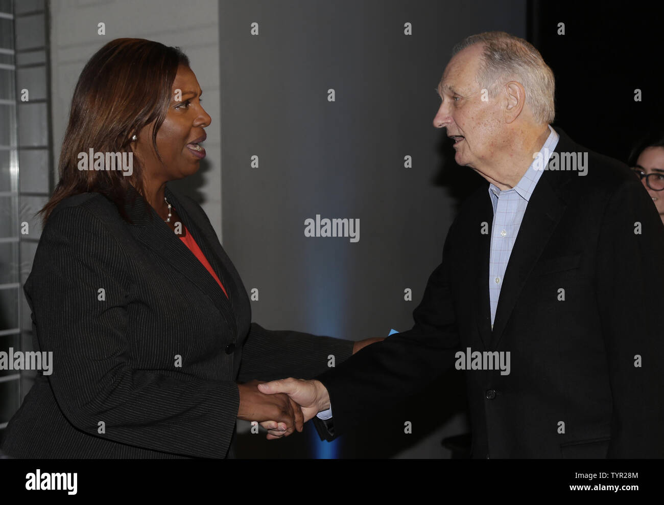 Alan Alda and NYC Public Advocate Letitia James arrive on the red carpet at 'The Walk' IMAX Special screening at the AMC Lincoln Square Theater on September 28, 2015 in New York City.     Photo by John Angelillo/UPI - Stock Image