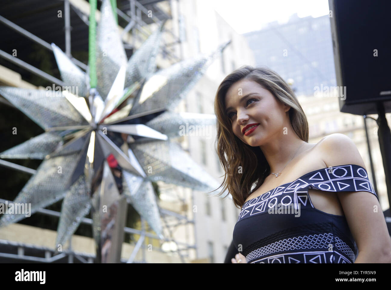 Super Model Miranda Kerr stands with the Swarovski Star before it is raised to the top of the world-famous Rockefeller Center Christmas tree on November 16, 2015 in New York City. 2015 marks the 12th year the Swarovski Star will adorn the Rockefeller Center Christmas tree. The Star is comprised of 25,000 crystals, with one million facets, and measures 9 and 1/2 feet in diameter and 1 1/2 feet deep. The Star weighs 550 pounds, including 300 pounds of crystal panels, and is composed of six outer rays and six smaller inner rays.       Photo by John Angelillo/UPI Stock Photo