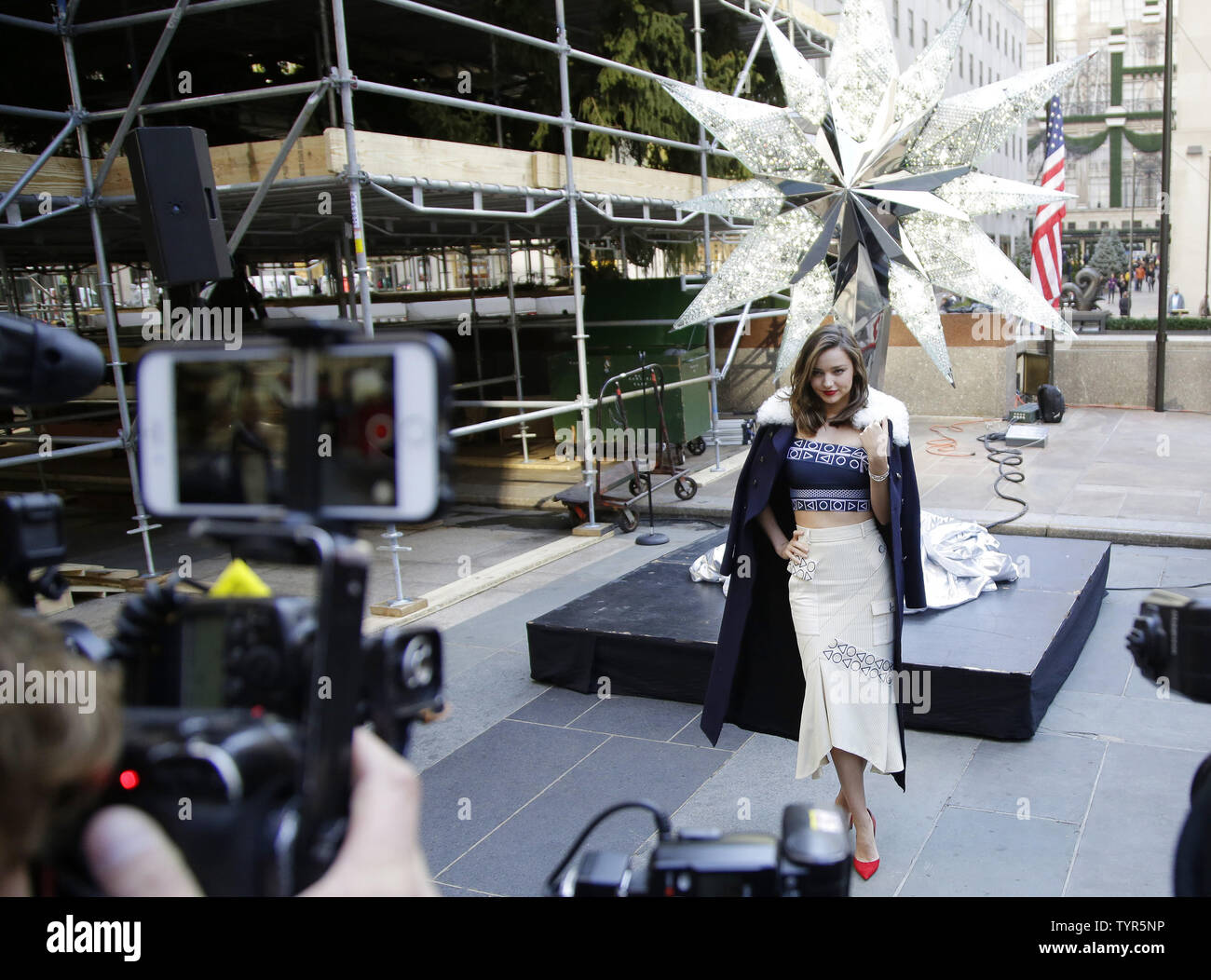 Super Model Miranda Kerr is photographed while standing near the Swarovski Star before it is raised to the top of the world-famous Rockefeller Center Christmas tree on November 16, 2015 in New York City. 2015 marks the 12th year the Swarovski Star will adorn the Rockefeller Center Christmas tree. The Star is comprised of 25,000 crystals, with one million facets, and measures 9 and 1/2 feet in diameter and 1 1/2 feet deep. The Star weighs 550 pounds, including 300 pounds of crystal panels, and is composed of six outer rays and six smaller inner rays.       Photo by John Angelillo/UPI Stock Photo