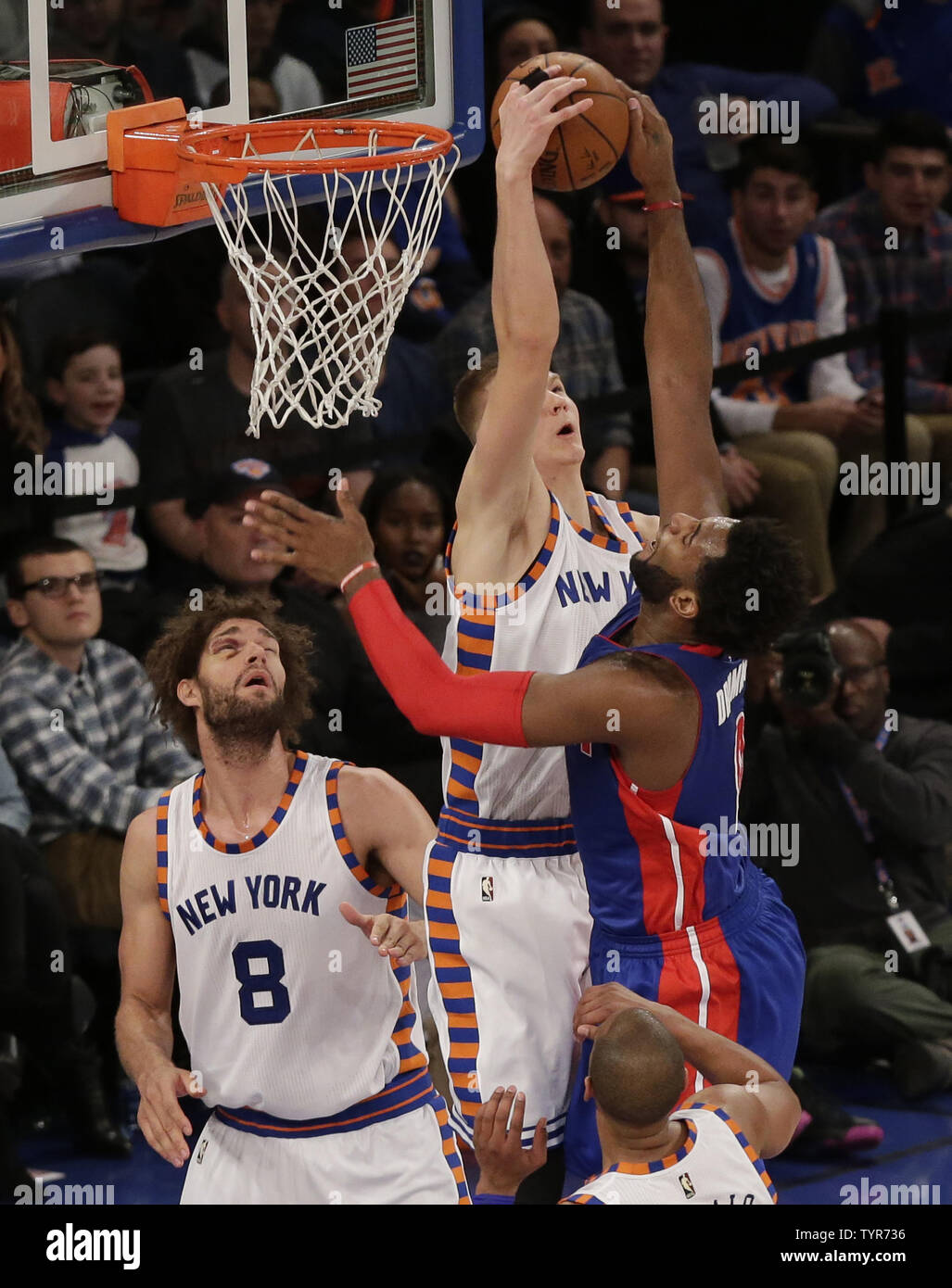New York Knicks Robin Lopez watches Kristaps Porzingis block a shot from Detroit Pistons Andre Drummond in the first half at Madison Square Garden in New York City on December 29, 2015.    Photo by John Angelillo/UPI Stock Photo