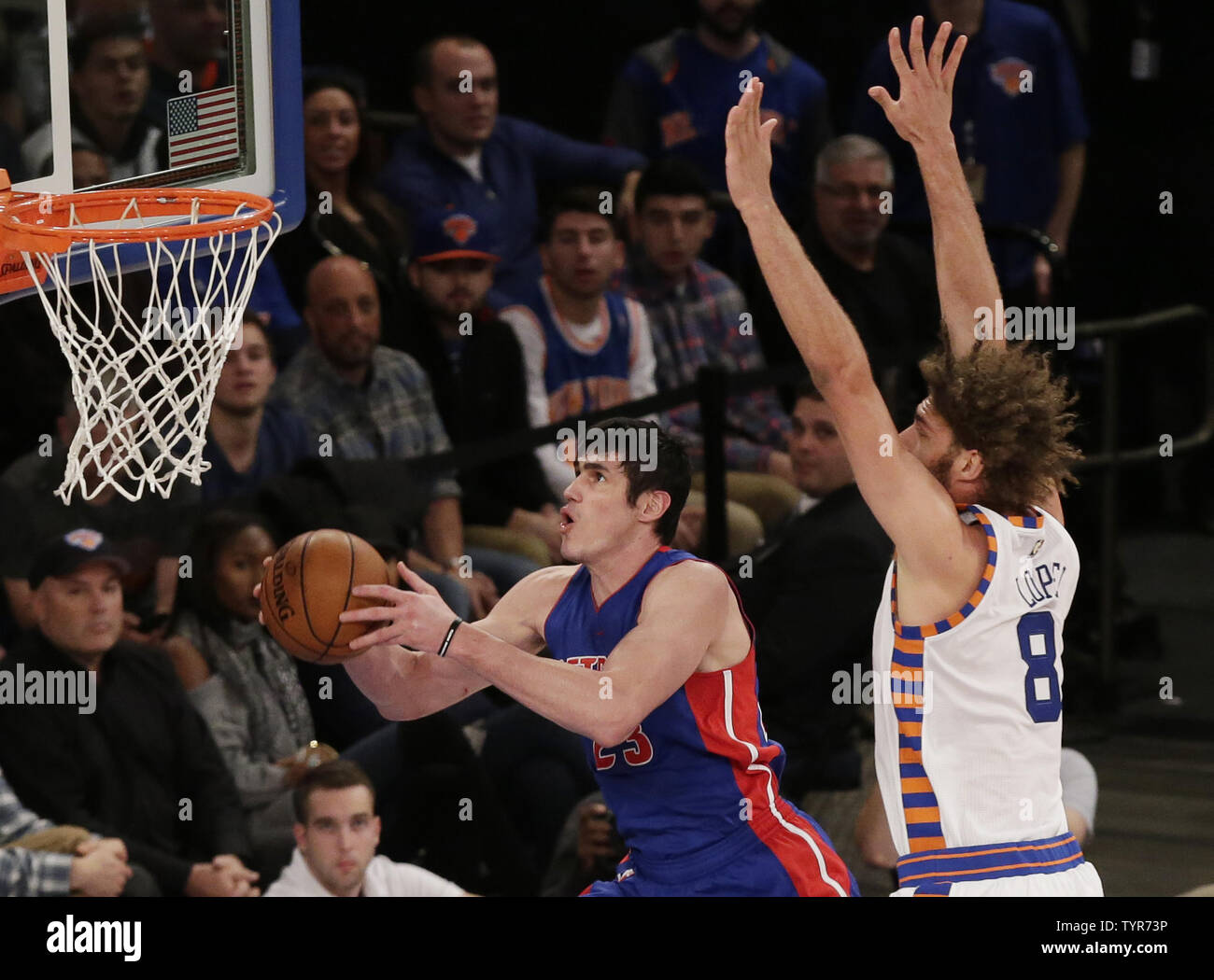 New York Knicks Robin Lopez defends Detroit Pistons Ersan Ilyasova who drives to the basket in the first quarter at Madison Square Garden in New York City on December 29, 2015.   Photo by John Angelillo/UPI Stock Photo