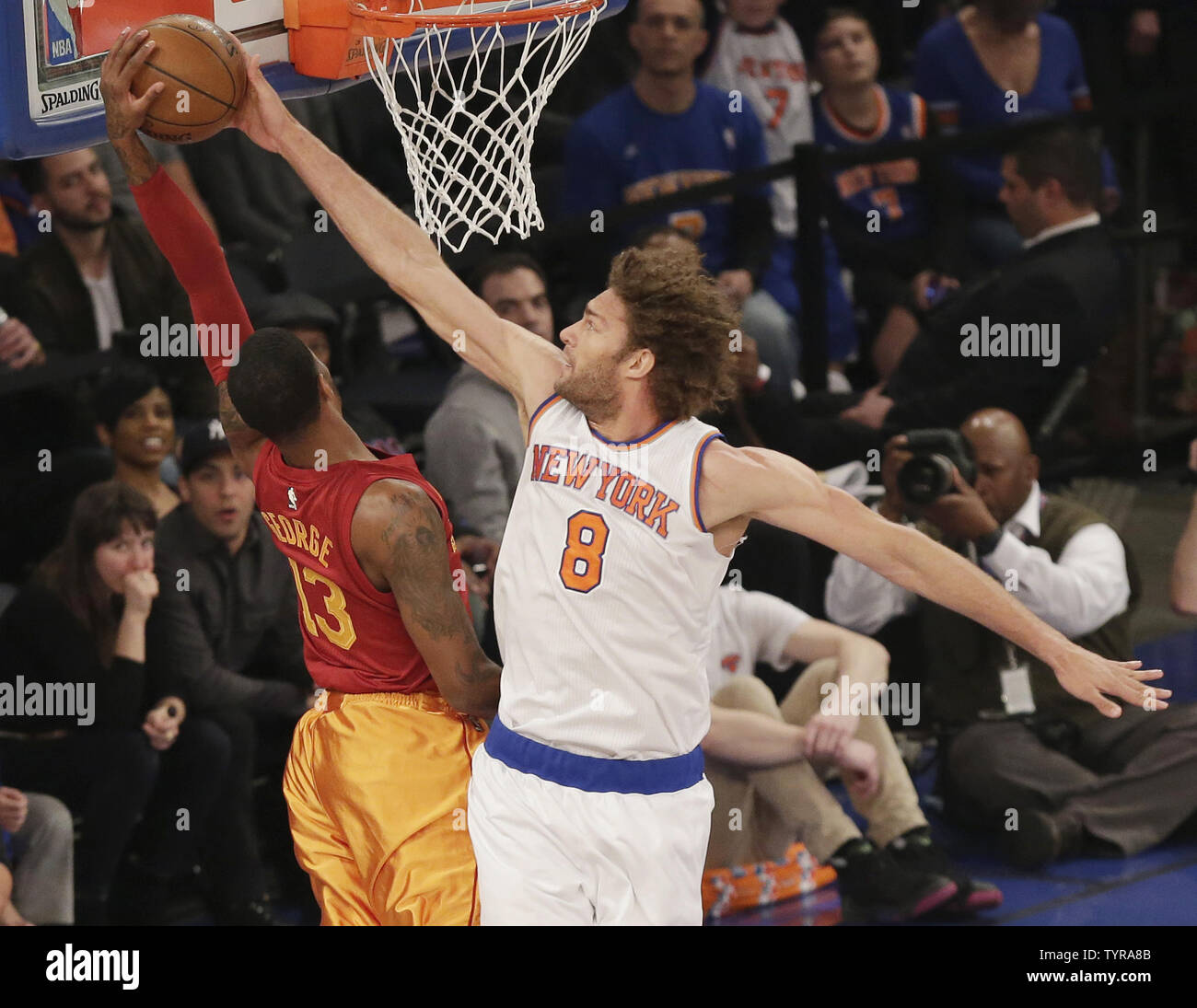 New York Knicks Robin Lopez blocks a shot from Indiana Pacers Paul George in the first half at Madison Square Garden in New York City on April 3, 2016.     Photo by John Angelillo/UPI Stock Photo