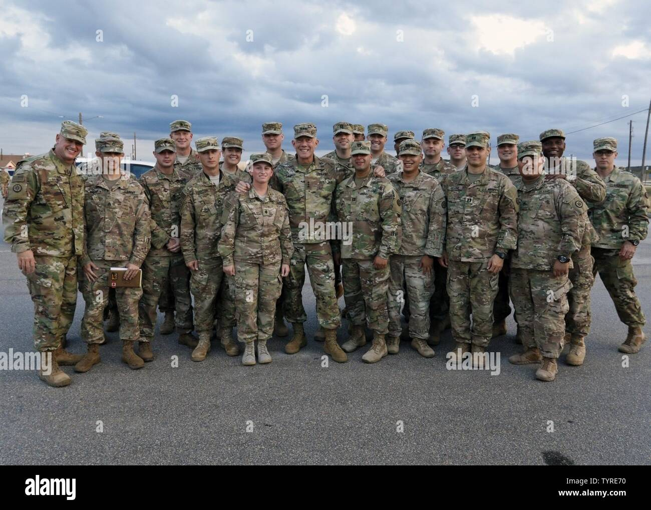 The Commanding General of the U.S. Army Reserve Command, Lt. Gen. Charles D. Luckey, poses with Soldiers from the 316th Sustainment Command (Expeditionary), a U.S. Army Reserve unit from Coraopolis, Pa. Nov. 22, 2016. - Stock Image