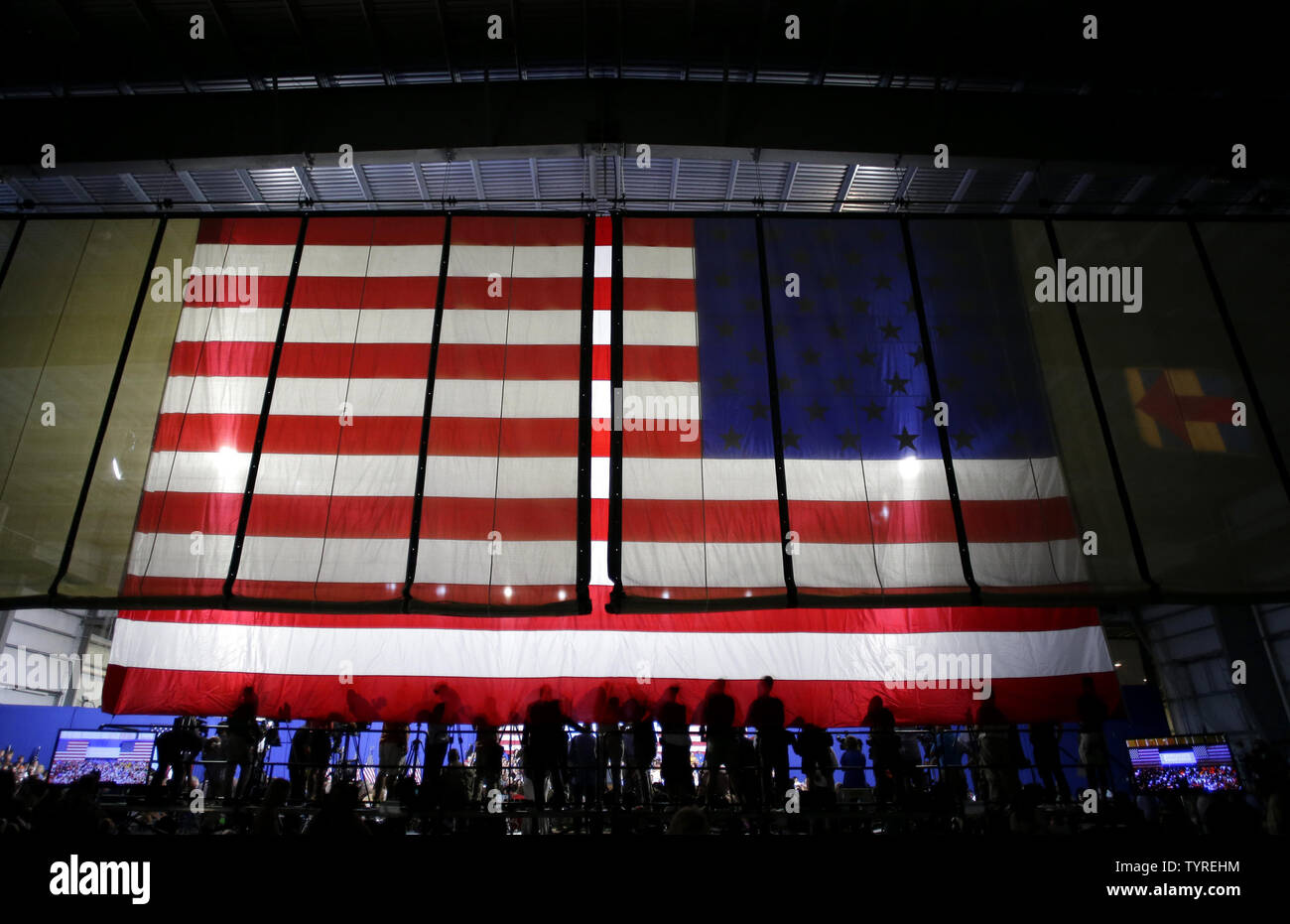 Members of the media stand on a riser in front of an American Flag as Democratic candidate for President Hillary Clinton and Vice President of the United States Joe Biden speak at Riverfront Sports in Scranton, Pennsylvania on August 15, 2016.    Photo by John Angelillo/UPI - Stock Image