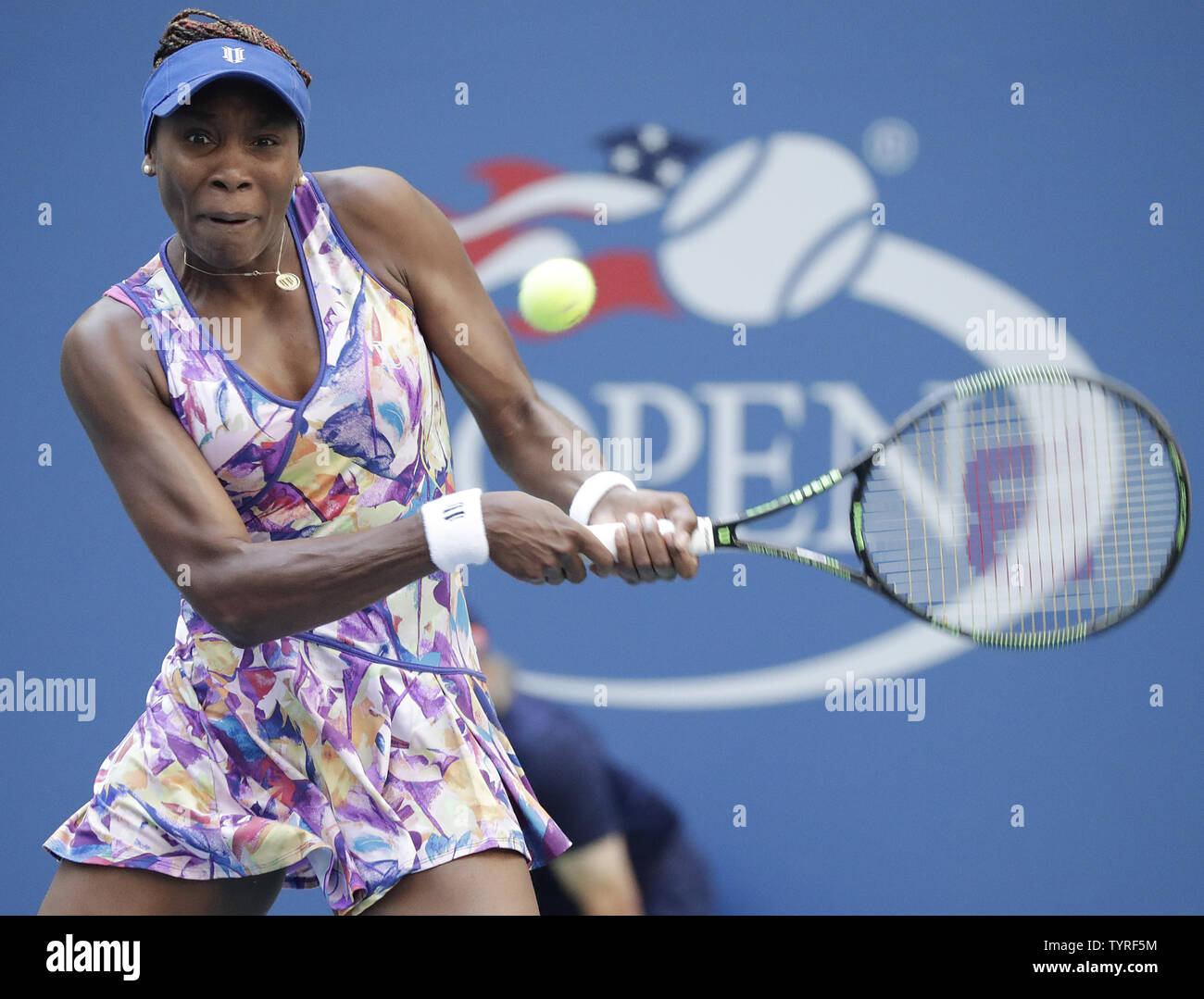 Venus Williams of the United States returns a ball to Kateryna Kozlova of the Ukraine in their first round match at the 2016 US Open Tennis Championships at the USTA Billie Jean King National Tennis Center in New York City on August 30, 2016.      Photo by John Angelillo/UPI - Stock Image