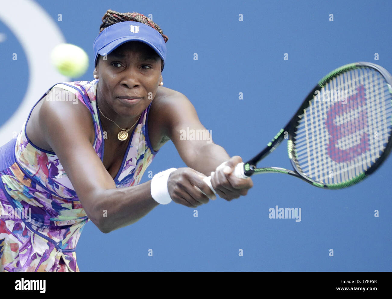 Venus Williams of the United States hits a backhand to Kateryna Kozlova of the Ukraine in their first round match at the 2016 US Open Tennis Championships at the USTA Billie Jean King National Tennis Center in New York City on August 30, 2016.      Photo by John Angelillo/UPI - Stock Image