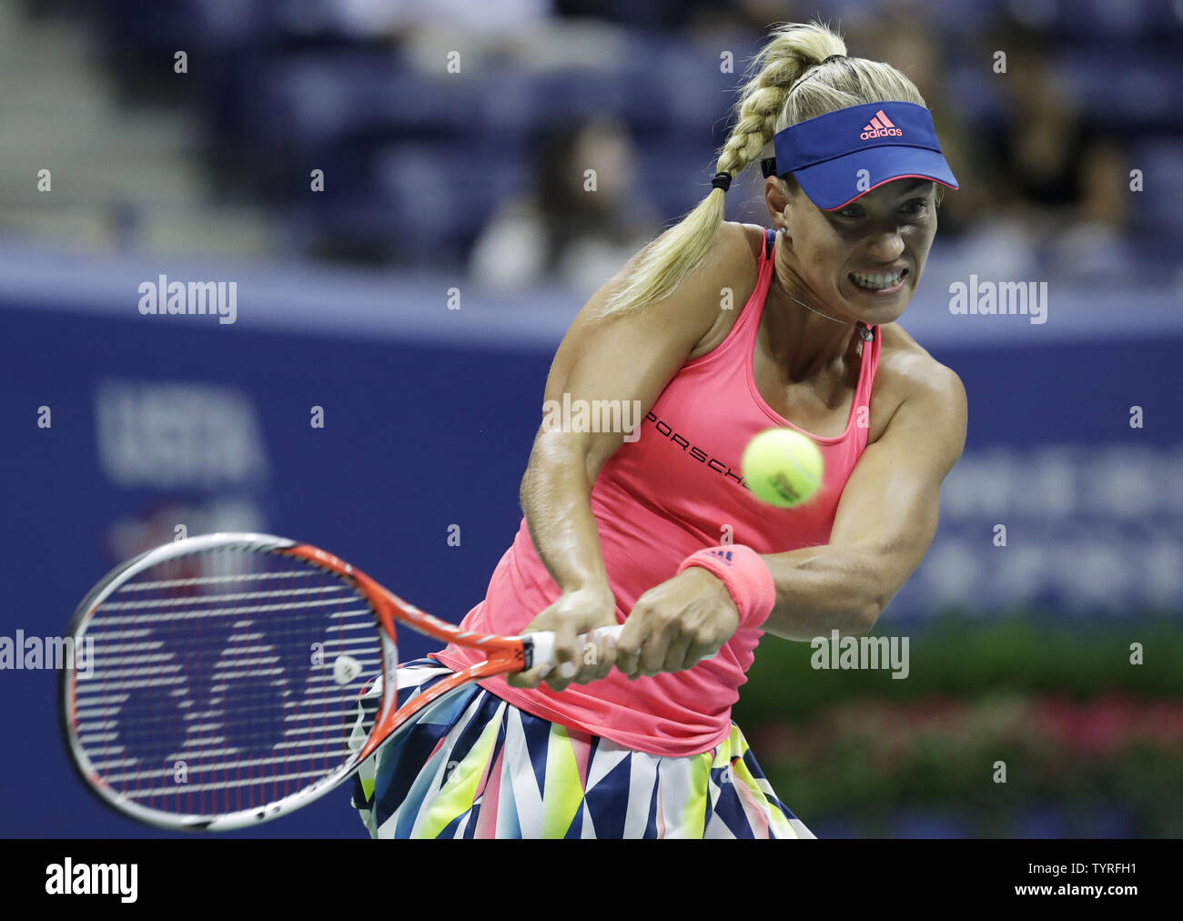 Angelique Kerber of Germany hits a backhand to Catherine Bellis of the United States in Arthur Ashe Stadium at the 2016 US Open Tennis Championships at the USTA Billie Jean King National Tennis Center in New York City on September 2, 2016.  Photo by John Angelillo/UPI - Stock Image