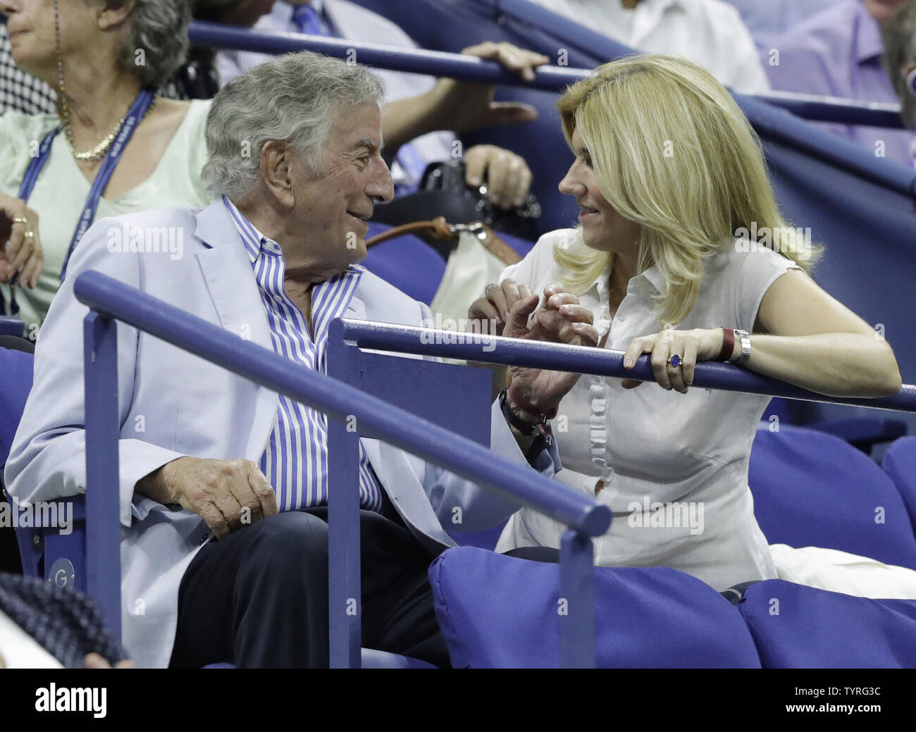Tony Bennett and Susan Crow watch Simona Halep of Romania play Serena Williams of the United States in the quarterfinals in Arthur Ashe Stadium at the 2016 US Open Tennis Championships at the USTA Billie Jean King National Tennis Center in New York City on September 7, 2016.     Photo by John Angelillo/UPI - Stock Image