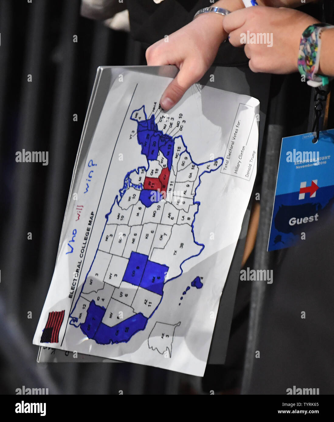 A Hillary supporter holds a map showing few states going for ...