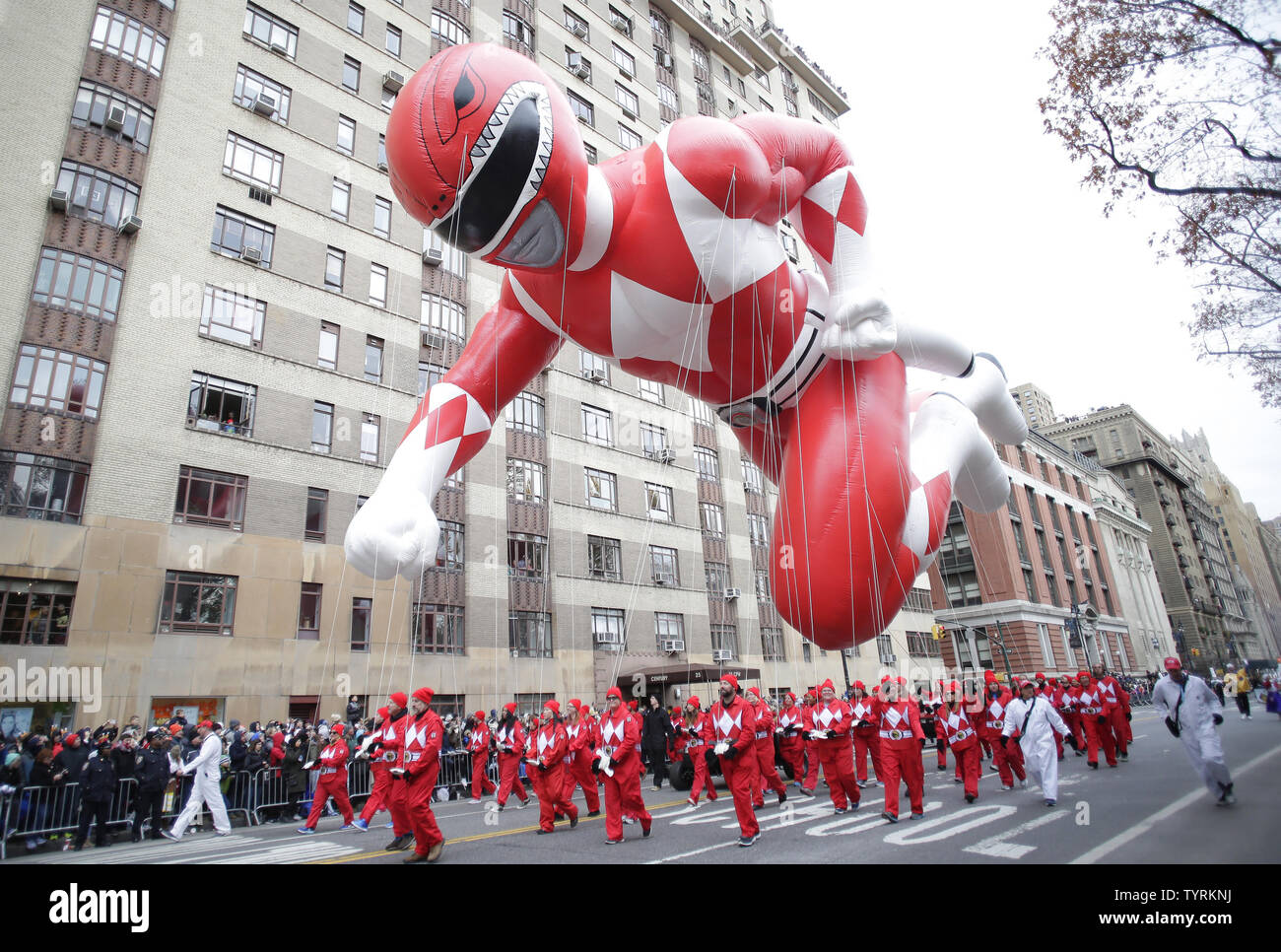 The Red Mighty Morphin Power Ranger balloon moves down the parade route at the 90th Macy's Thanksgiving Day Parade in New York City on November 24, 2016.     Photo by John Angelillo/UPI - Stock Image