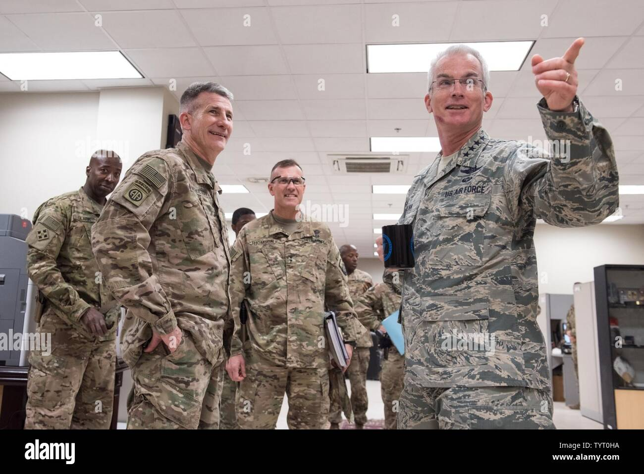 U.S. Air Force Gen. Paul J. Selva, right, vice chairman of the Joint Chiefs of Staff, meets with U.S. Army Gen. John W. Nicholson, left, Resolute Support and U.S. Forces – Afghanistan commander, and U.S. Army Maj. Gen. John Thomson, center, U.S. Forces – Afghanistan deputy commander for support, at Bagram Airfield, Afghanistan, Nov. 24, 2016. Gen. Selva and his wife, Ricki Selva, visited troops across Afghanistan to spend Thanksgiving Day with them and thank them for their service. Stock Photo