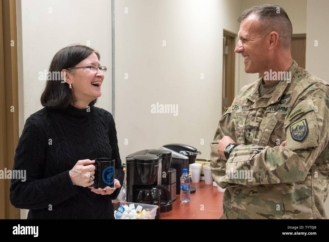Mrs. Ricki Selva, wife of U.S. Air Force Gen. Paul J. Selva, vice chairman of the Joint Chiefs of Staff, speaks with U.S. Army Maj. Gen. John Thomson, U.S. Forces – Afghanistan deputy commander for support, at Bagram Airfield, Afghanistan, Nov. 24, 2016. Gen. Selva and Mrs. Selva visited troops across Afghanistan to spend Thanksgiving Day with them and thank them for their service. Stock Photo