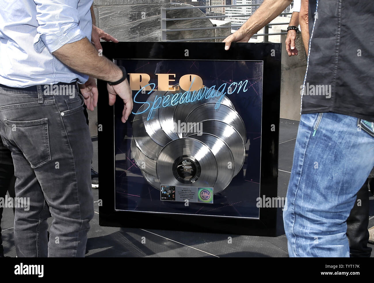 Kevin Cronin of REO Speedwagon and band members hold a
