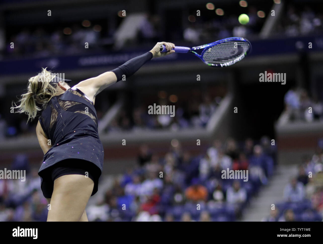 Maria Sharapova Of Russia Serves To Sofia Kenin In Their 3rd Round Match On Day 5