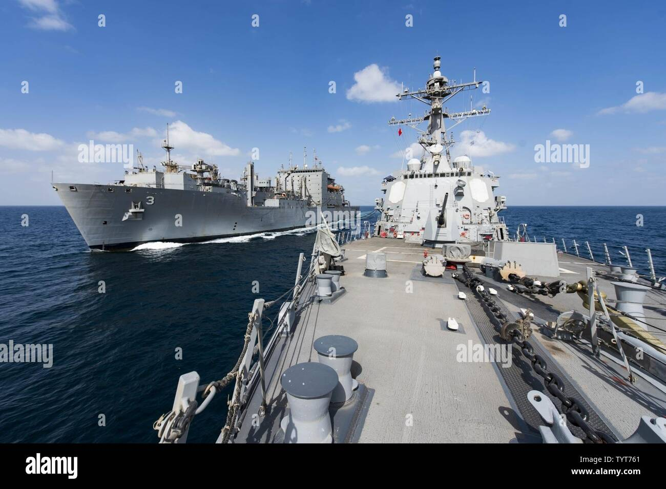SEA (Nov. 25, 2016) The guided-missile destroyer USS Nitze (DDG 94) conducts an underway replenishment with the dry cargo and ammunition ship USNS Alan Shepard (T-AKE 3). Nitze, deployed as part of the Eisenhower Carrier Strike Group, is supporting maritime security operations and theater security cooperation efforts in the U.S. 5th Fleet area of operations. - Stock Image