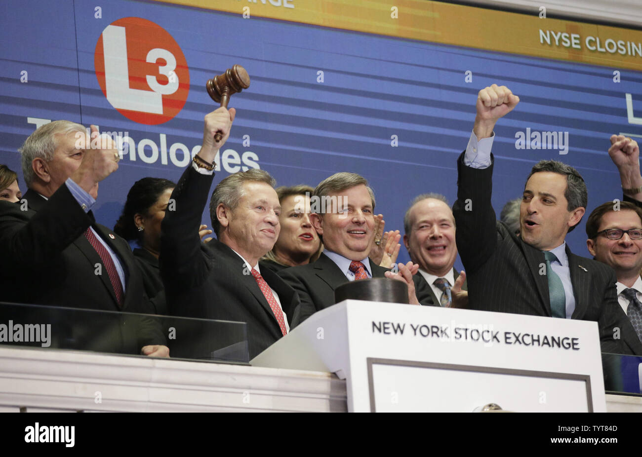 representatives of L3 Technologies ring the closing bell at the New York Stock Exchange on Wall Street in New York City on January 10, 2018. The S&P 500 and Nasdaq close lower for the first time in 2018. The Dow Jones industrial average fell 16.67 points to 25,369.13.      Photo by John Angelillo/UPI - Stock Image