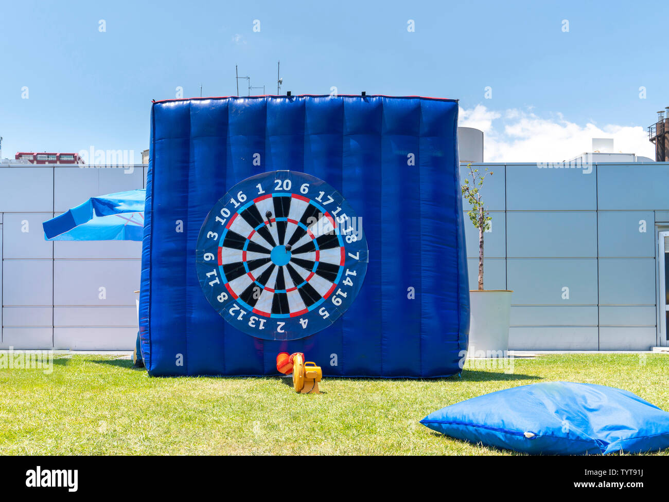 Giant inflatable dart board in outside/outdoor. - Stock Image