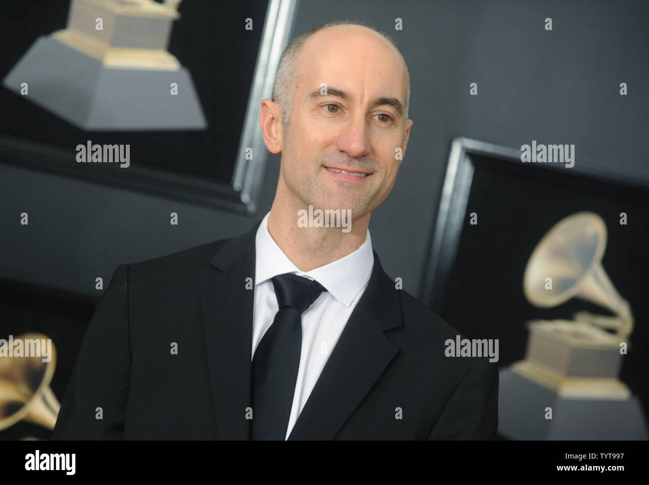 Alan Ferber arrives on the red carpet at the 60th Annual Grammy Awards ceremony at Madison Square Garden in New York City on January 28, 2018. The CBS network will broadcast the show live from Madison Square Garden in New York City. It will be the first time since 2003 that the ceremony will not be held in Los Angeles.       Photo by Dennis Van Tine/UPI - Stock Image