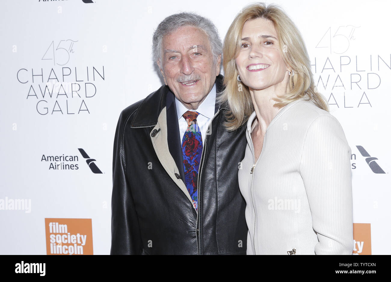 Tony Bennett and Susan Crow arrive on the red carpet at the 45th Chaplin Award Gala at Alice Tully Hall in Lincoln Center on April 30, 2018 in New York City.    Photo by John Angelillo/UPI - Stock Image