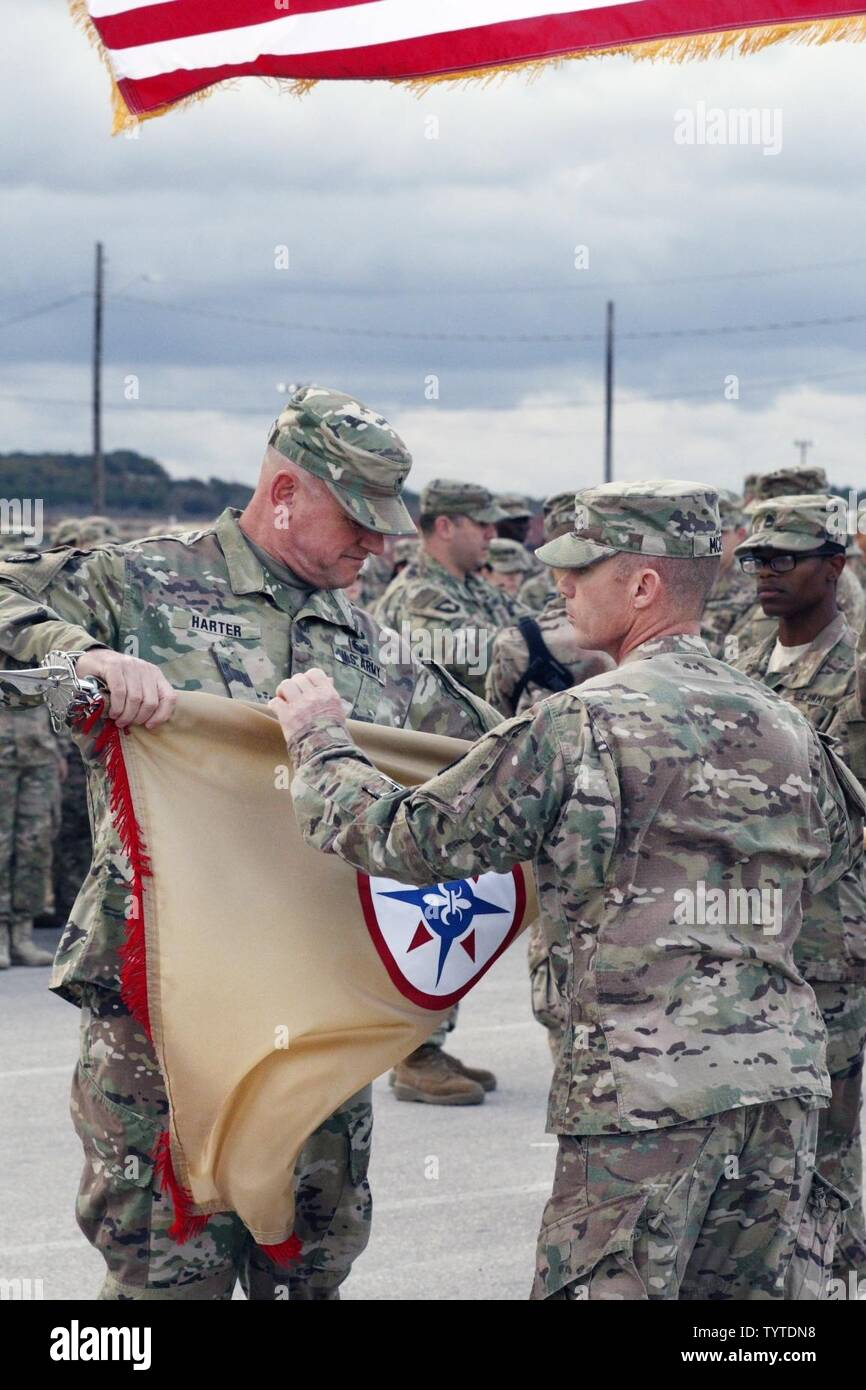 (Left) Brig. Gen. Robert D. Harter, Commanding General of the 316th Sustainment Command (Expeditionary), cases the 316th ESC guidon with Command Sgt. Maj. Johnny McPeek (Right), the 316th ESC Command Sergeant Major, during a Colors Casing ceremony at Fort Hood, Texas Nov. 28, 2016. - Stock Image