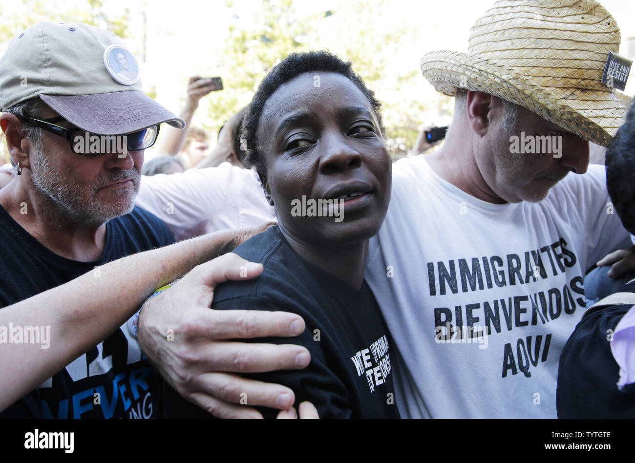 Statue Of Liberty climber and Rise and Resist protester Therese Okoumou exits Court with supporters in New York City on July 5, 2018 in New York City. The woman who partially climbed up the Statue of Liberty on July 4th Independence Day and prompted authorities to evacuate Liberty Island was released without bail, and if convicted would face up to six months behind bars.    Photo by John Angelillo/UPI Stock Photo