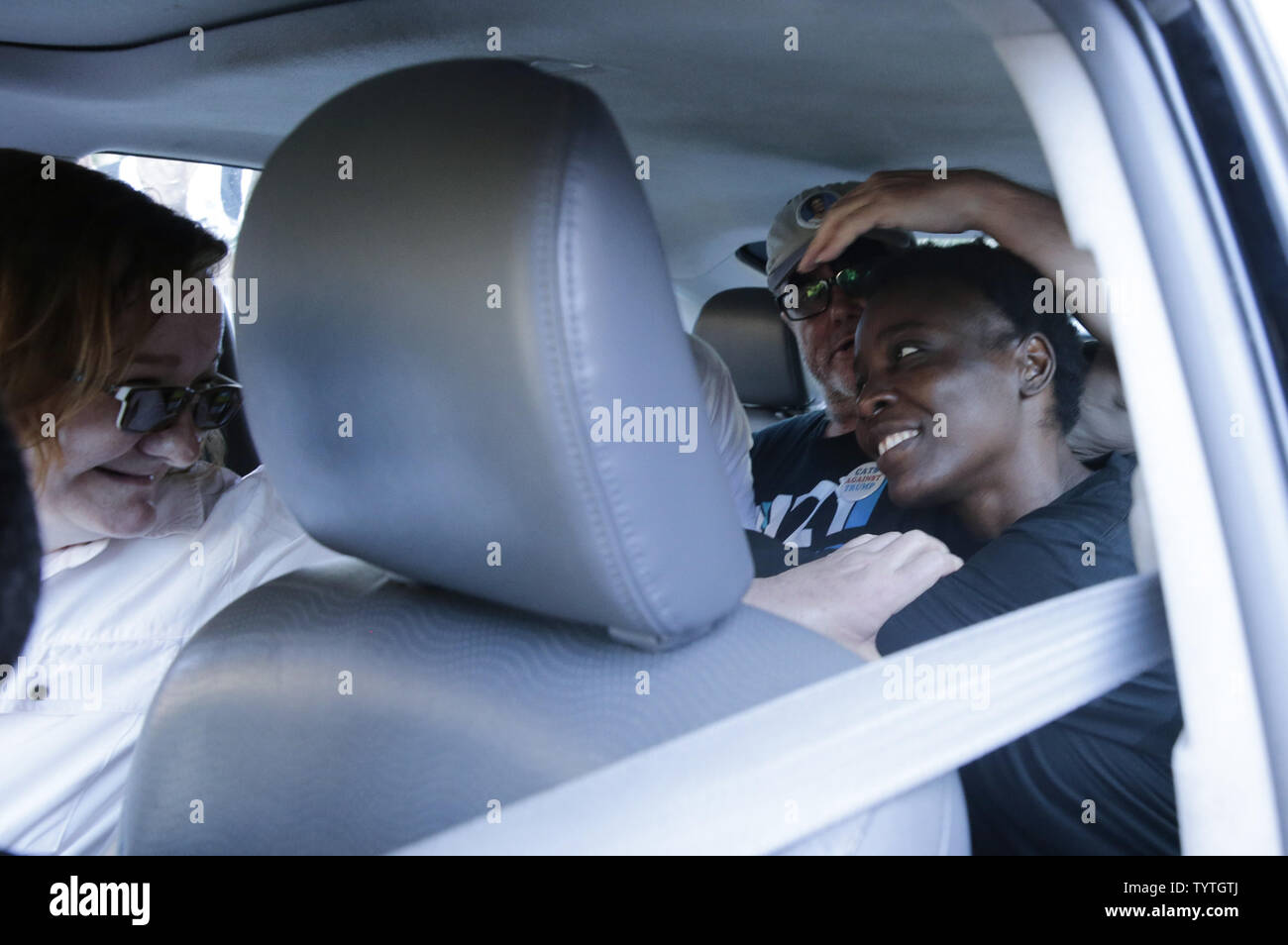 Statue Of Liberty climber and Rise and Resist protester Therese Okoumou smiles as she waits for the car to depart after she exits Court with supporters in New York City on July 5, 2018 in New York City. The woman who partially climbed up the Statue of Liberty on July 4th Independence Day and prompted authorities to evacuate Liberty Island was released without bail, and if convicted would face up to six months behind bars.    Photo by John Angelillo/UPI Stock Photo