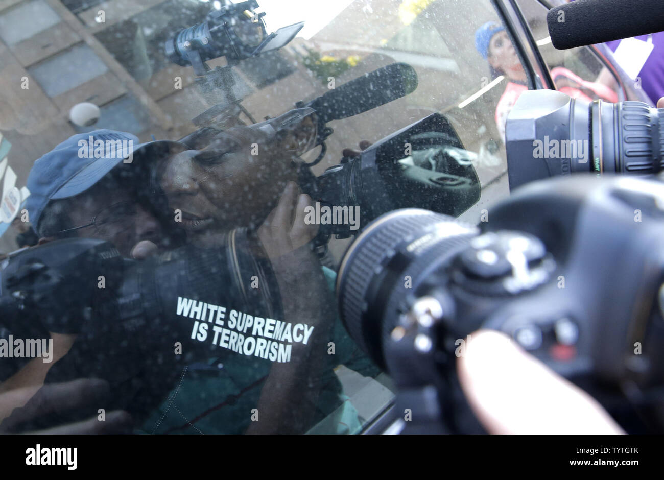 Statue Of Liberty climber and Rise and Resist protester Therese Okoumou waits for the car to depart after she exits Court with supporters in New York City on July 5, 2018 in New York City. The woman who partially climbed up the Statue of Liberty on July 4th Independence Day and prompted authorities to evacuate Liberty Island was released without bail, and if convicted would face up to six months behind bars.    Photo by John Angelillo/UPI Stock Photo