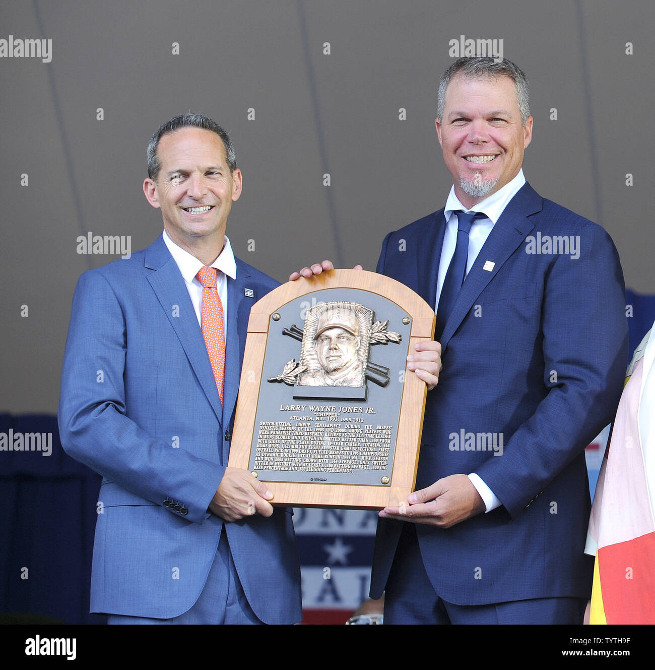 Atlanta Braves Chipper Jones  and President of the Baseball Hall of Fame Jeff Idelson holds his plaque before he delivers his Baseball Hall of Fame induction speech at the Clark Sports Center in Cooperstown, NY on July 29, 2018.  A record 60 Hall of Famers are scheduled to be in Central New York to honor Vladimir Guerrero, Trevor Hoffman, Chipper Jones, Jack Morris, Jim Thome and Alan Trammell at the National Baseball Hall of Fame and Museum during Hall of Fame Weekend on July 27-30.     Photo by George Napolitano/UPI - Stock Image