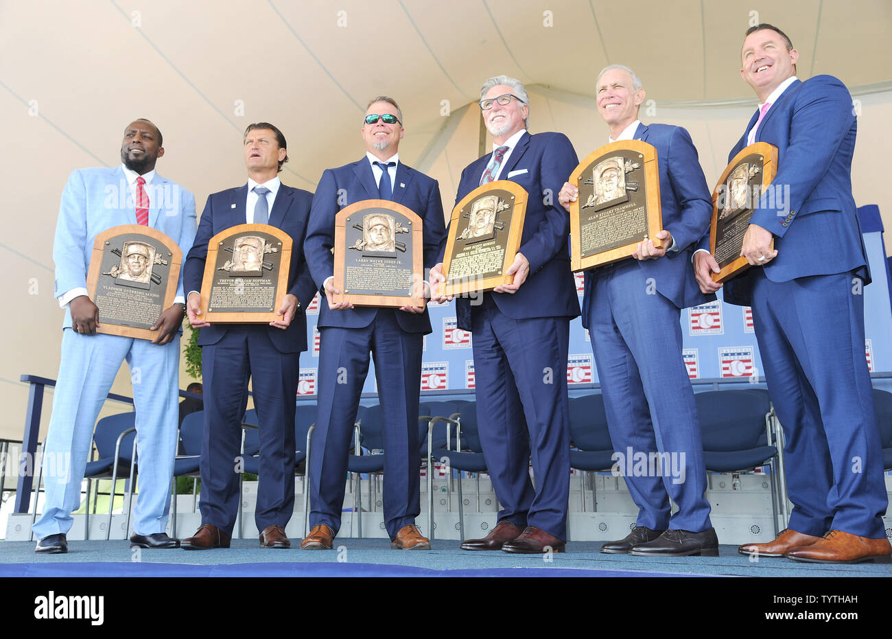 Vladmir Guerrero, Trevor Hoffman, Chipper Jones, Jack Morris, Alan Trammell and Jim Thome on stage holding their induction plaques after delivering their Baseball Hall of Fame induction speech at the Clark Sports Center in Cooperstown, NY on July 29, 2018.  A record 60 Hall of Famers are scheduled to be in Central New York to honor Vladimir Guerrero, Trevor Hoffman, Chipper Jones, Jack Morris, Jim Thome and Alan Trammell at the National Baseball Hall of Fame and Museum during Hall of Fame Weekend on July 27-30.     Photo by George Napolitano/UPI - Stock Image
