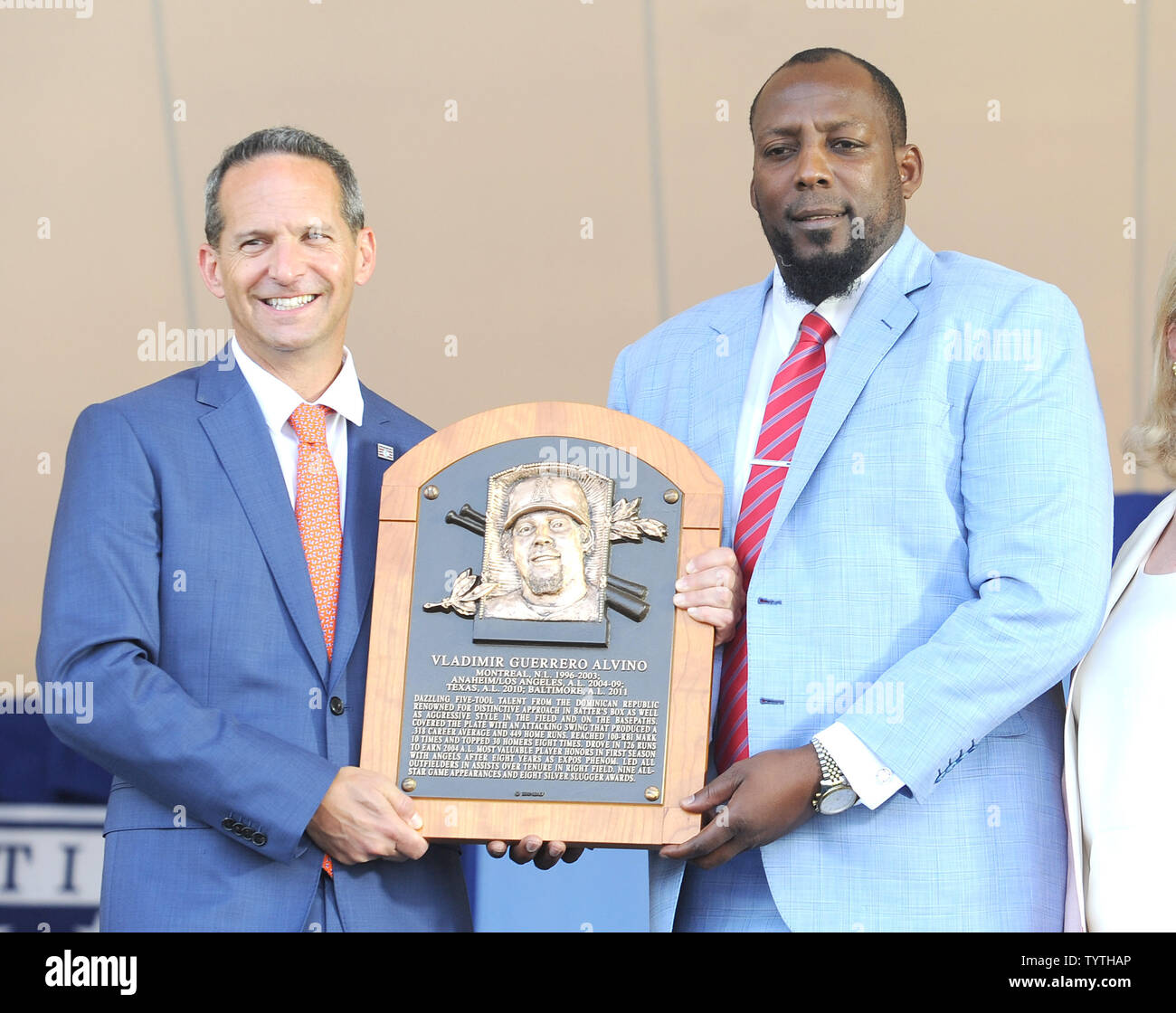 Vladmir Guerrero and President of the Baseball Hall of Fame Jeff Idelson holds his plaque before he delivers his  Baseball Hall of Fame induction speech at the Clark Sports Center in Cooperstown, NY on July 29, 2018.  A record 60 Hall of Famers are scheduled to be in Central New York to honor Vladimir Guerrero, Trevor Hoffman, Chipper Jones, Jack Morris, Jim Thome and Alan Trammell at the National Baseball Hall of Fame and Museum during Hall of Fame Weekend on July 27-30.     Photo by George Napolitano/UPI - Stock Image