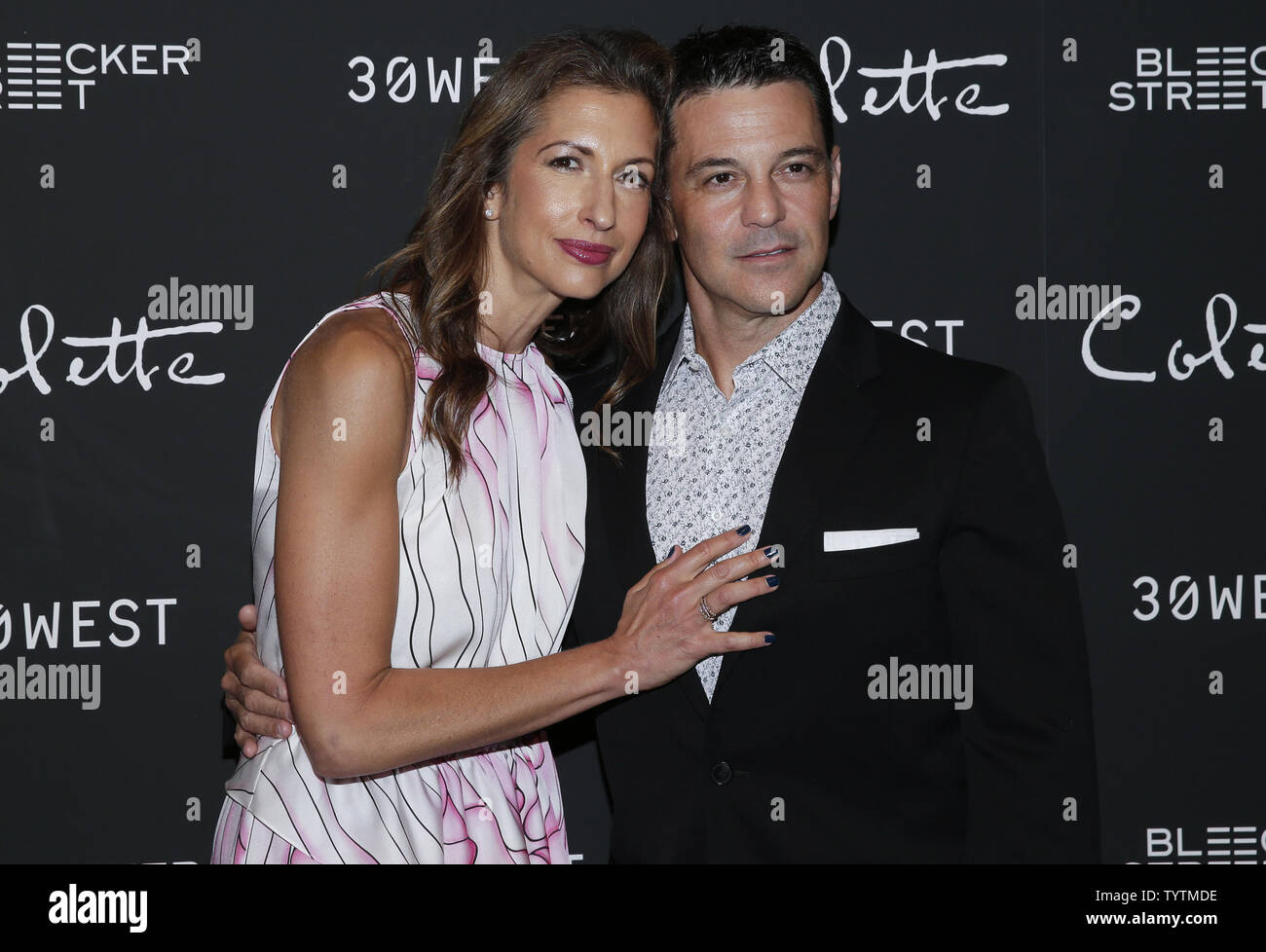 Alysia Reiner and David Alan Basche arrive on the red carpet at the New York screening of 'Colette' at Museum of Modern Art on September 13, 2018 in New York City.     Photo by John Angelillo/UPI - Stock Image