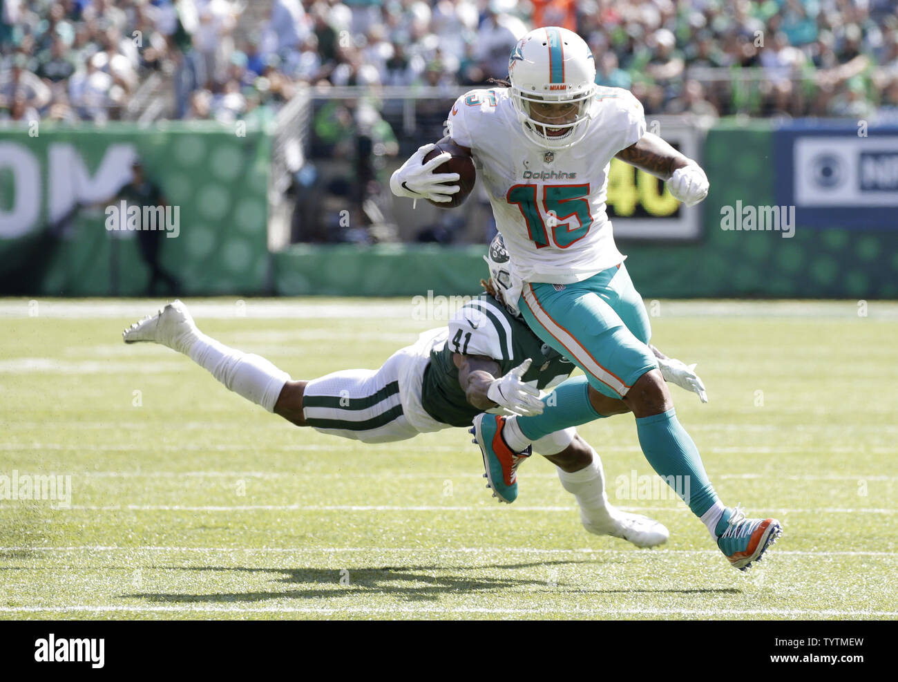 super popular eb33d 0c532 New York Jets Buster Skrine dives to try to tackle Miami ...