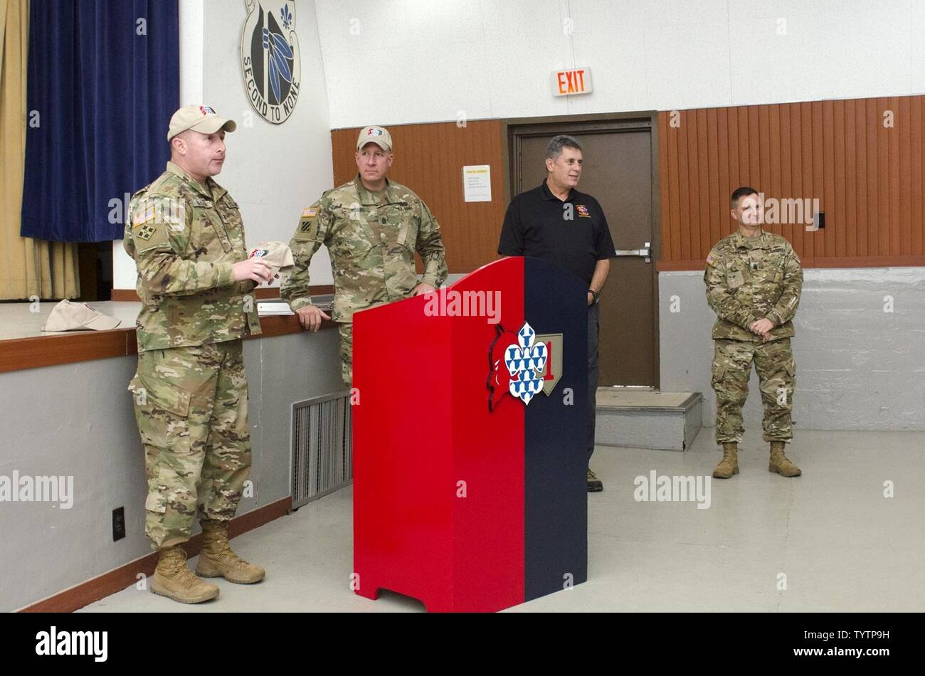 CAMP HOVEY, Republic of Korea – Col. Timothy Hayden (left), the commander of the 1st Armored Brigade Combat Team, 1st Infantry Division, introduces Sgt. Maj. Alan Hummel, senior enlisted leader to the Armor School at the Maneuver Center of Excellence, Fort Benning, Ga., to 1st ABCT Soldiers during the Armor School's visit at the Hovey Multipurpose Complex, Camp Hovey, South Korea, Nov 29. - Stock Image
