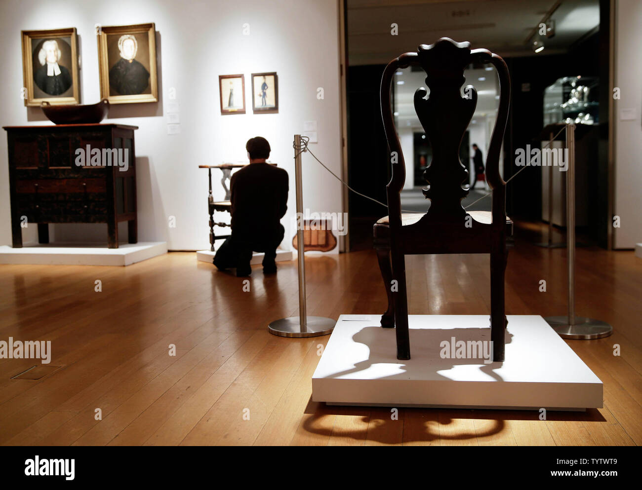 A Queen Anne Carved Walnut chair is on display at a press preview of an upcoming auction titled 'Important American Furniture, Folk Art, Silver and Prints' at Christie's in New York City on January 12, 2019. The auction features Ammi Phillips' 'Girl in a Red Dress with a Dog', and Edward Hicks' 'Peaceable Kingdom, both estd $800,000 - $1.2 million. The auction takes place on January 17th and 18th.     Photo by John Angelillo/UPI - Stock Image