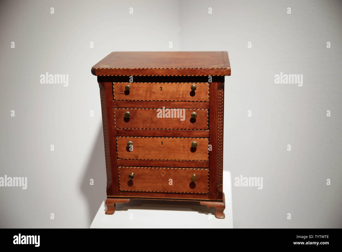 A small wooden chest is on display at a press preview of auction titled 'Important American Furniture, Folk Art, Silver and Prints' at Christie's in New York City on January 12, 2019. The auction features Ammi Phillips' 'Girl in a Red Dress with a Dog', and Edward Hicks' 'Peaceable Kingdom, both estd $800,000 - $1.2 million. The auction takes place on January 17th and 18th.     Photo by John Angelillo/UPI - Stock Image
