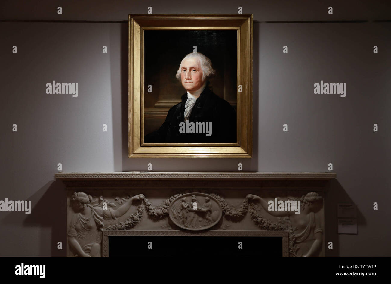 A portrait of George Washington is on display at a press preview of an upcoming auction titled 'Important American Furniture, Folk Art, Silver and Prints' at Christie's in New York City on January 12, 2019. The auction features Ammi Phillips' 'Girl in a Red Dress with a Dog', and Edward Hicks' 'Peaceable Kingdom, both estd $800,000 - $1.2 million. The auction takes place on January 17th and 18th.     Photo by John Angelillo/UPI - Stock Image