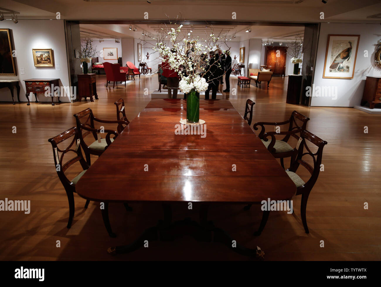 Furniture and works of art are on display at a press preview of an upcoming auction titled 'Important American Furniture, Folk Art, Silver and Prints' at Christie's in New York City on January 12, 2019. The auction features Ammi Phillips' 'Girl in a Red Dress with a Dog', and Edward Hicks' 'Peaceable Kingdom, both estd $800,000 - $1.2 million. The auction takes place on January 17th and 18th.     Photo by John Angelillo/UPI - Stock Image