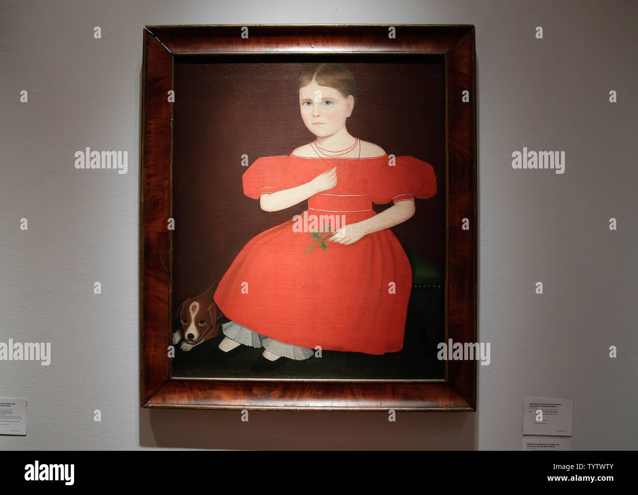 Ammi Phillips' 'Girl in a Red Dress with a Dog', is on display  at a press preview of an upcoming auction titled 'Important American Furniture, Folk Art, Silver and Prints' at Christie's in New York City on January 12, 2019. The auction features Ammi Phillips' 'Girl in a Red Dress with a Dog', and Edward Hicks' 'Peaceable Kingdom, both estd $800,000 - $1.2 million. The auction takes place on January 17th and 18th.     Photo by John Angelillo/UPI - Stock Image
