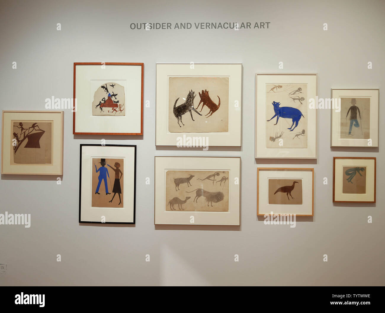 Works of art are on display at a press preview of an upcoming auction titled 'Outsider and Vernacular Art' at Christie's in New York City on January 12, 2019. The auction featuring Henry Darger's '148 At Jennie Richee During fury of storm are unsuccessfully attached (sic) by Glandelinians / 149 At Jennie Richee narrowly escape capture but Blengins come to rescue, double sided' , estd $250,000 - $500,000 and Bill Traylor's 'Goat, Camel, Lion and Figures', estd $75,000 - $100,000 takes place at Christie's on January 18th.     Photo by John Angelillo/UPI - Stock Image